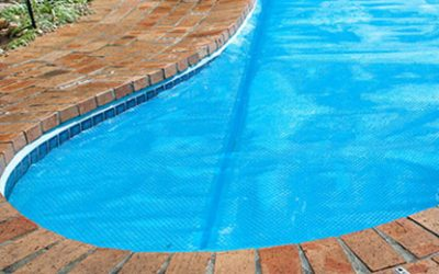 HOW A POOL COVER CAN SAVE YOU MONEY